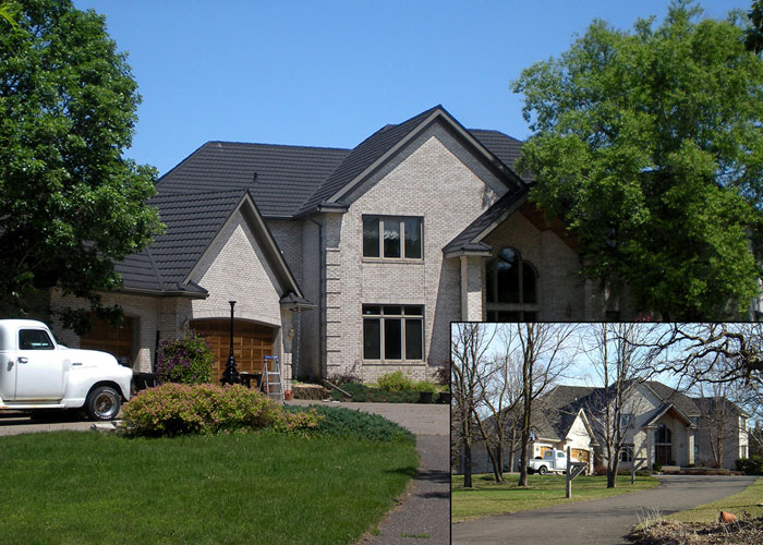 Large residential home with architectural shingles on peaked roof.