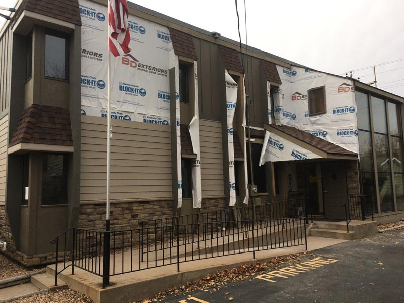 BD Exteriors team in process of siding replacement on Castle Realty office in St. Cloud.