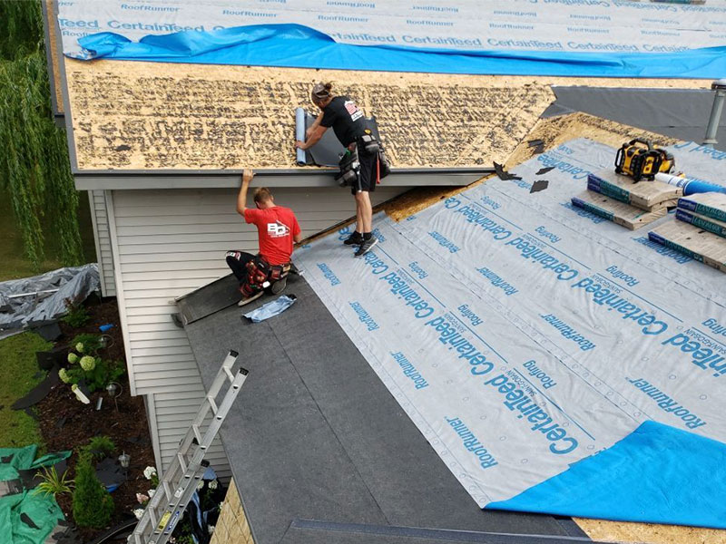 BD Exteriors team replacing the roof and siding on the Eric & Missy Greene home in St. Cloud after a hail storm.